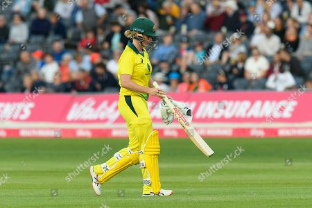 Wicket - Beth Mooney of Australia looks dejected as she walks back to the pavilion after being dismissed by Katherine Brunt of England during the 3rd Vitality International T20 match between England Women Cricket and Australia Women at the Bristol County Ground, Bristol