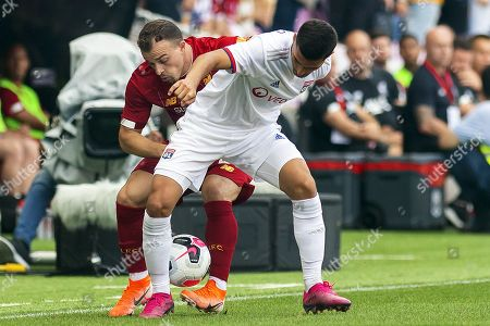 Liverpool's Xherdan Shaqiri (L) in action against Lyon's Houssem Aouar (R) during a friendly soccer match between Liverpool FC and Olympique Lyon in Geneva, Switzerland, 31 July 2019.