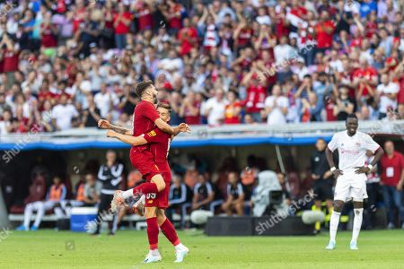 Liverpool's Harry Wilson (C) celebrates with his teammate Adam Lallana (L) after scoring their third goal during a friendly soccer match between Liverpool FC and Olympique Lyon in Geneva, Switzerland, 31 July 2019.