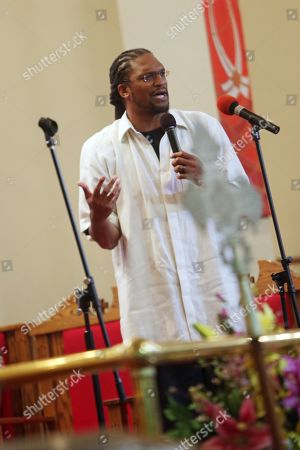 Stock Photo of Etan Thomas speaks during the 5th Anniversary event.
