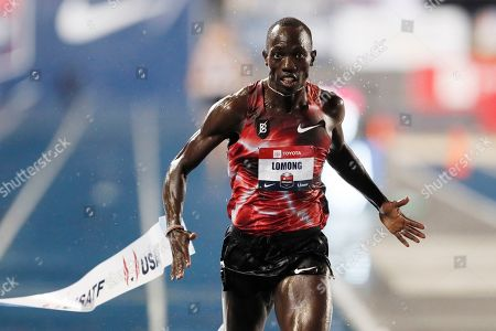 Lopez Lomong wins the men's 10,000-meter run at the U.S. Championships athletics meet, in Des Moines, Iowa