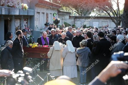 Montevideo's Archbishop, Daniel Sturla (L), leads a ceremony at the funeral of Maria Auxiliadora Delgado, wife of the country's President, Tabare Vazquez, in the cemetery of La Teja, in Montevideo, Uruguay, 31 July 2019. Delgado passed away early on the same day due to a heart attack and her remains will be buried at La Teja cemetery.