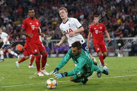 Sven Ulreich of Bayern Munich denies Oliver Skipp of Tottenham Hotspur during Tottenham Hotspur vs FC Bayern Munich, Audi Cup Final Football at the Allianz Arena on 31st July 2019