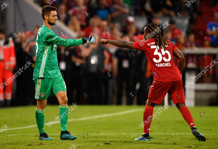 Bayern Munich's goalkeeper Sven Ulreich (L) and Renato Sanches (R) react during the penalty shootout of the Audi Cup final soccer match between Tottenham Hotspur and Bayern Munich in Munich, Germany, 31 July 2019.