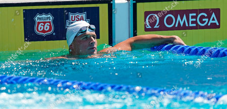 Ryan Lochte looks on after competing in the men's 200-meter individual medley time trial at the U.S. national swimming championships in Stanford, Calif., . Lochte is returning from a 14-month suspension