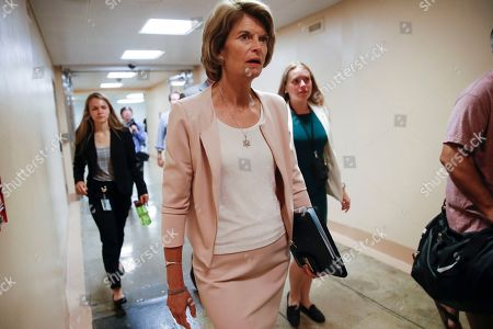 Stock Image of Sen. Lisa Murkowski, R-Alaska, walks to the Senate chamber for votes on federal judges as a massive budget pact between House Speaker Nancy Pelosi and President Donald Trump is facing a key vote in the GOP-held Senate later, at the Capitol in Washington