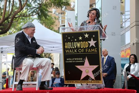 Stacy Keach, Malgosia Tomassi Keach. Stacy Keach, left, listens as his wife Malgosia Tomassi Keach speaks at the ceremony honoring him with a star at the Hollywood Walk of Fame, in Los Angeles