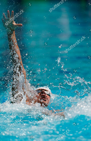 Ryan Lochte competes in the men's 200-meter individual medley time trial at the U.S. national swimming championships in Stanford, Calif., . Lochte is returning from a 14-month suspension
