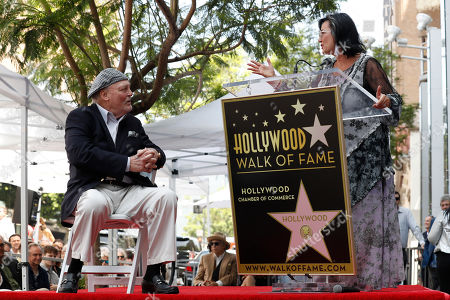 Stacy Keach (L) listens as his wife Malgosia Tomassi Keach (R) delivers a speech during the unveiling ceremony of his star on the Hollywood Walk of Fame, in Hollywood, California, USA, 31 July 2019. Keach received the 2,668th star on the Hollywood Walk of Fame, dedicated in the Category of Television.