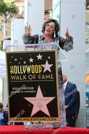 Malgosia Tomassi Keach speaks at a ceremony honoring him with a star at the Hollywood Walk of Fame, in Los Angeles