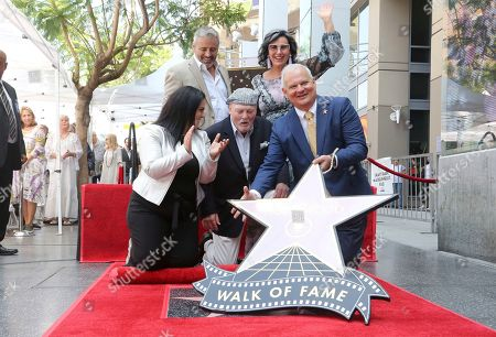 Stock Photo of Rana Ghadban, Matt LeBlanc, Stacy Keach, Malgosia Tomassi Keach, Jeff Zarrinnam. Rana Ghadban, from left, Matt LeBlanc, Stacy Keach, Malgosia Tomassi Keach and Jeff Zarrinnam unveil a star at a ceremony honoring Stacy Keach with a star at the Hollywood Walk of Fame, in Los Angeles