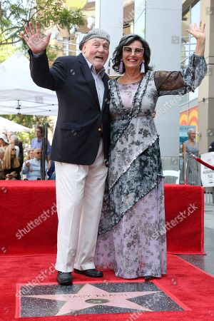 Stacy Keach, Malgosia Tomassi Keach. Stacy Keach, left, and his wife Malgosia Tomassi Keach pose atop a star following a ceremony honoring Stacy Keach with a star at the Hollywood Walk of Fame, in Los Angeles