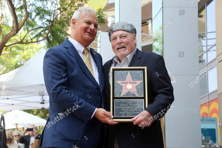 Jeff Zarrinnam, Stacy Keach. Jeff Zarrinnam, left, and Stacy Keach hold a miniaturette of a star during a ceremony honoring Stacy Keach with a star at the Hollywood Walk of Fame, in Los Angeles