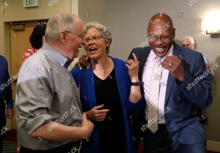 State Rep. Laurie Jinkins, D-Tacoma, center, shares a laugh with Rep. John Lovick, D-Mill Creek, right, and Rep. Frank Chopp, D-Seattle, following a caucus meeting and vote by Democrats choosing Jinkins as Washington state's speaker of the House, the first woman in that role, in SeaTac, Wash. Jinkins was one of four women representatives seek the top spot after Chopp, the state's longest-serving speaker, announced he was stepping down from his leadership position but would remain in the Legislature. Lovick has been serving as acting speaker since May, and will remain in that role until the speaker-designate is approved by the full House at the start of the 2020 legislative session in January