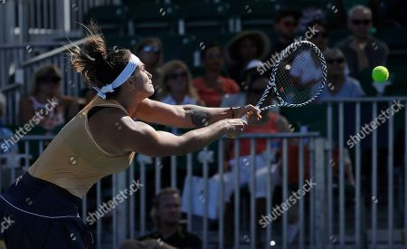 Aryna Sabalenka, of Belarus, reaches for a shot form CoCo Vandeweghe, of the United States, during the Mubadala Silicon Valley Classic tennis tournament in San Jose, Calif