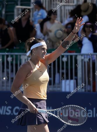 Aryna Sabalenka, of Belarus, waves after defeating CoCo Vandeweghe, of the United States, during the Mubadala Silicon Valley Classic tennis tournament in San Jose, Calif