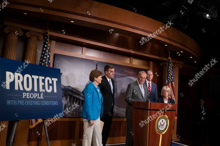 Stock Image of United States Senate Minority Leader Chuck Schumer, center, with, fropm left, United States Senator Jeanne Shaheen, United States Senator Mark Warner, United States Senator Ron Wyden and United States Senator Patty Murray discuss saving pre-existing condition protections in the health care system during a press conference on Capitol Hill