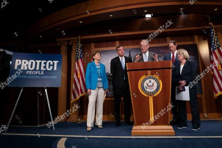United States Senate Minority Leader Chuck Schumer, center, with, fropm left, United States Senator Jeanne Shaheen, United States Senator Mark Warner, United States Senator Ron Wyden and United States Senator Patty Murray discuss saving pre-existing condition protections in the health care system during a press conference on Capitol Hill