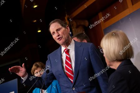 United States Senator Ron Wyden discusses saving pre-existing condition protections in the health care system during a press conference on Capitol Hill