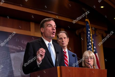 Stock Image of United States Senator Mark Warner, joined by United States Senator Ron Wyden and United States Senator Patty Murray, discusses saving pre-existing condition protections in the health care system during a press conference on Capitol Hill