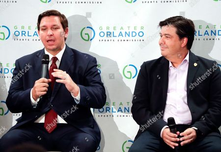 Ron DeSantis, Alex Leitao. Florida Gov. Ron DeSantis, left, speaks during a news conference as Alex Leitao, CEO of the Orlando City Soccer Club. listens prior to the MLS All-Star soccer match, in Orlando, Fla