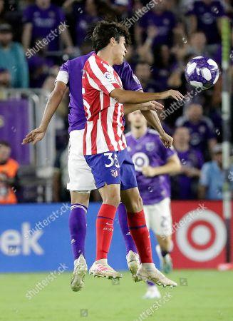 Manu Sanchez, Carlos Vela. Atletico Madrid defender Manu Sanchez (35) tries to get position on Los Angeles FC forward Carlos Vela, back left, during the first half of the MLS All-Star soccer match, in Orlando, Fla
