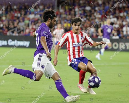 Carlos Vela, Manu Sanchez. Los Angeles FC forward Carlos Vela, left, tries to get position for a shot against Atletico Madrid defender Manu Sanchez (35) during the first half of the MLS All-Star soccer match, in Orlando, Fla