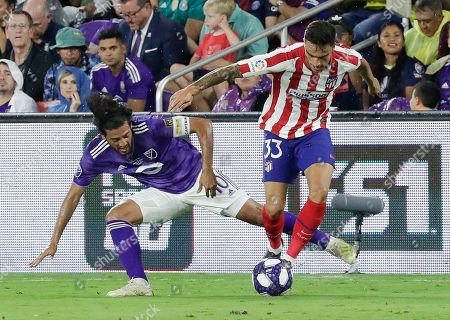 Carlos Isaac, Carlos Vela. Atletico Madrid defender Carlos Isaac (33) moves the ball away from Los Angeles FC forward Carlos Vela, left, during the first half of the MLS All-Star soccer match, in Orlando, Fla
