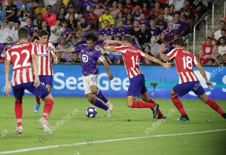 Carlos Vela, Marcos Llorente, Felipe, Mario Hermoso. Los Angeles FC forward Carlos Vela (10) tries to moves the ball past Atletico Madrid midfielder Marcos Llorente (14), defender Felipe (18) and defender Mario Hermoso (22) during the first half of the MLS All-Star soccer match, in Orlando, Fla