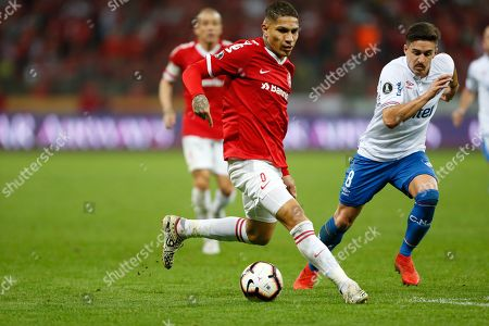 Internacional's Paolo Guerrero (L) vies for the ball with Gabriel Neves (R) of Nacional during the Copa Libertadores round 16 second leg match between Internacional Sport Club of Brazil and Nacional of Uruguay at the Beira-Rio stadium in Porto Alegre, Brazil, 31 July 2019.