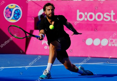 Tennis player Ernests Gulbis of Latvia in action against Argentina's Diego Schwartzman during the third day of the Los Cabos Tennis Open in Los Cabos, Baja California, Mexico, 31 July 2019.