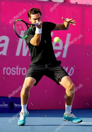 Stock Image of Tennis player Ernests Gulbis of Latvia in action against Argentina's Diego Schwartzman during the third day of the Los Cabos Tennis Open in Los Cabos, Baja California, Mexico, 31 July 2019.