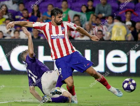 Diego Costa, Bastian Schweinsteiger. Atletico Madrid forward Diego Costa, right, scores a goal as he gets off a shot past Chicago Fire defender Bastian Schweinsteiger during the second half of the MLS All-Star soccer match, in Orlando, Fla