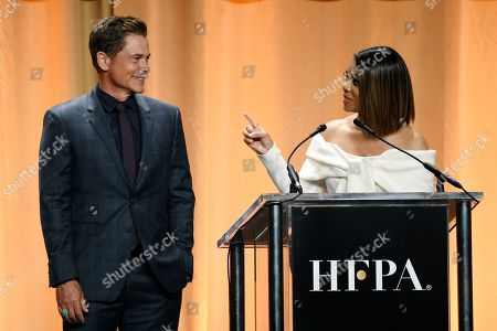 Rob Lowe, Regina Hall. Actor Rob Lowe, left, and actress Regina Hall share the stage at the 2019 Hollywood Foreign Press Association's Annual Grants Banquet at the Beverly Wilshire Hotel, in Beverly Hills, Calif