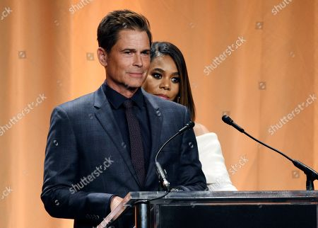 Regina Hall, Rob Lowe. Actress Regina Hall sneaks behind actor Rob Lowe onstage at the 2019 Hollywood Foreign Press Association's Annual Grants Banquet at the Beverly Wilshire Hotel, in Beverly Hills, Calif