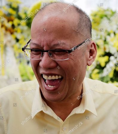 Former Filipino President Benigno 'Noynoy' Aquino III reacts next to the tomb of former President Corazon 'Cory' Aquino and former Senator Benigno 'Ninoy' Aquino during a mass in Paranaque City, south of Manila, Philippines, 01 August 2019. Family, relatives, and supporters of former president  Corazon Aquino, the first woman president who led the period of transition back to democratic government in 1986 after 20 years of martial law and authoritarian rule, offered a tribute on her 10th death anniversary on her grave on 01 August.