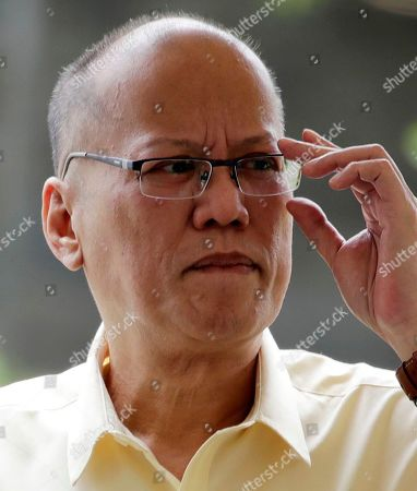 Former Filipino President Benigno 'Noynoy' Aquino III gestures next to the tomb of former President Corazon 'Cory' Aquino and former Senator Benigno 'Ninoy' Aquino during a mass in Paranaque City, Philippines, 01 August 2019. Family, relatives, and supporters of former president  Corazon Aquino, the first woman president who led the period of transition back to democratic government in 1986 after 20 years of martial law and authoritarian rule, offered a tribute on her 10th death anniversary on her grave on 01 August.