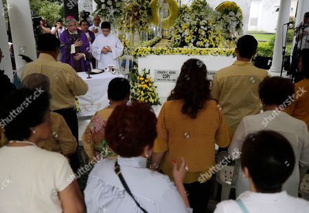 A Filipino priest leads a mass next to the tomb of former President Corazon 'Cory' Aquino and former Senator Benigno 'Ninoy' Aquino during a mass in Paranaque City, Philippines, 01 August 2019. Family, relatives, and supporters of former president  Corazon Aquino, the first woman president who led the period of transition back to democratic government in 1986 after 20 years of martial law and authoritarian rule, offered a tribute on her 10th death anniversary on her grave on 01 August.