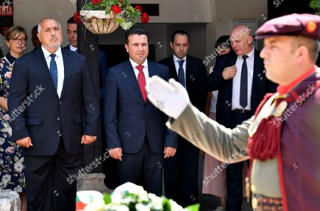 Bulgarian Prime Minister Boyko Borissov (2-L) and his North Macedonian counterpart Zoran Zaev (C) attend a wreath laying ceremony at the grave of Macedonian revolutionary Goce Delcev in the garden of Orthodox church St. Spas in Skopje, Republic of North Macedonia, 01 August 2019. Bulgarian Prime Minister Boyko Borissov is in North Macedonia for a one-day official visit.