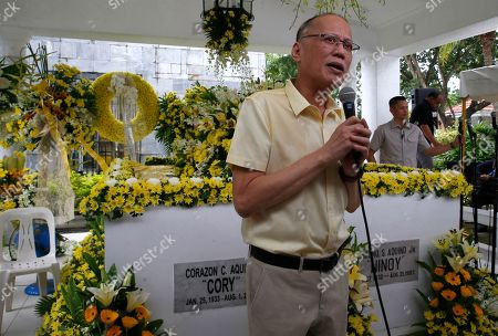 "Former Philippine President Benigno Aquino III addresses supporters following a mass at the tombs of his parents, the late President Corazon ""Cory"" Aquino, left, and assassinated opposition Senator Benigno Aquino Jr., to commemorate the 10th Death Anniversary of the late President in suburban Paranaque city south of Manila, Philippines. Cory Aquino, who died Aug. 1, 2009 after a long illness, was installed to the Presidency via a near-bloodless ""People Power"" revolution that toppled the late dictator Ferdinand Marcos from 20-year-rule"