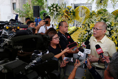 "Stock Picture of Former Philippine President Benigno Aquino III talks to the media following a mass at the tombs of his parents, the late President Corazon ""Cory"" Aquino and assassinated opposition Senator Benigno Aquino Jr., to commemorate the 10th Death Anniversary of the late President in suburban Paranaque city, south of Manila, Philippines. Cory Aquino, who died Aug. 1, 2009 after a long illness, was installed to the Presidency via a near-bloodless ""People Power"" revolution that toppled the late dictator Ferdinand Marcos from 20-year-rule"