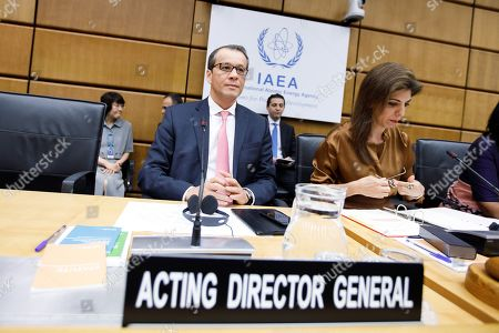 Stock Photo of Cornel Feruta (L), the Acting Director General of the International Atomic Energy Agency (IAEA) and Leena Al-Hadid (R), Chairperson of IAEA Board of Governors prepare for the start of the IAEA Board of Governors meeting at the IAEA headquarters of the United Nations (UN) seat in Vienna, Austria, 01 August 2019. The board of governors is expected to discuss the successor of IAEA director Yukiya Amano, who died at the age of 72 on 18 July 2019.