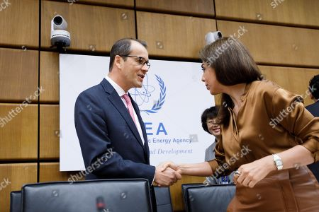 Stock Image of Cornel Feruta (L), the Acting Director General of the International Atomic Energy Agency (IAEA) and Leena Al-Hadid (R), Chairperson of IAEA Board of Governors meeting at the IAEA headquarters of the United Nations (UN) seat in Vienna, Austria, 01 August 2019. The board of governors is expected to discuss the successor of IAEA director Yukiya Amano, who died at the age of 72 on 18 July 2019.