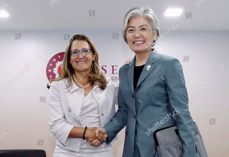 South Korea's Foreign Minister Kang Kyung-wha (R) shakes hands with her Canadian counterpart Chrystia Freeland in Bangkok, Thailand, 01 August 2019, on the sidelines of the 52nd ASEAN (Association of Southeast Asian Nations) Foreign Ministers' Meeting and Related Meeting.