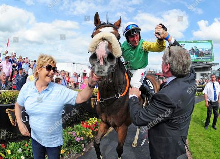 GALWAY. The Guinness Galway Hurdle. TUDOR CITY and jockey Robert Power with groom Cathy O'Leary are greeted by owner John Breslin after win.