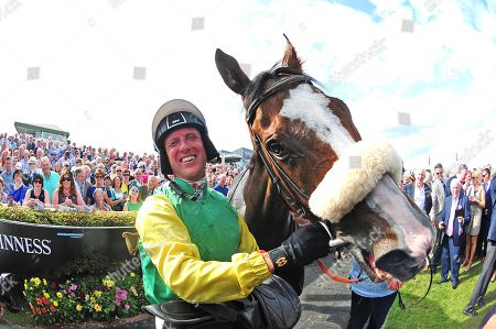 GALWAY. The Guinness Galway Hurdle. TUDOR CITY won for jockey Robert Power and trainer Tony Martin.