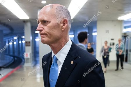 Republican Senator from Florida Rick Scott walks near the Senate subway to the Senate floor for a series of votes, including a vote on a two-year budget plan, on Capitol Hill in Washington, DC, USA, 01 August 2019. The Senate passed a two-year budget plan, the Bipartisan Budget Act of 2019, that will increase spending from current levels by 320 billion USD and suspend the federal borrowing limit for two years.