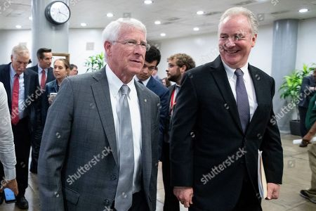 Republican Senator from Mississippi Roger Wicker (L) and Democratic Senator from Maryland Chris Van Hollen (R) walk together near the Senate subway to the Senate floor for a series of votes, including a vote on a two-year budget plan, on Capitol Hill in Washington, DC, USA, 01 August 2019. The Senate passed a two-year budget plan, the Bipartisan Budget Act of 2019, that will increase spending from current levels by 320 billion USD and suspend the federal borrowing limit for two years.