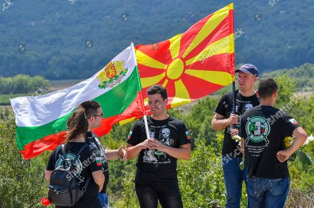 Young boys hold Bulgarian and North Macedonia's flags during the ceremony of official unveiling of the newly built monument of Bulgarian Colonel Konstantin Kavarnaliev who died in betel of Dojran during the second Balkan war in 1913, near Dojran, Republic of North Macedonia, 01 August 2019. Bulgarian Prime Minister Boyko Borissov is in North Macedonia for a one-day official visit.