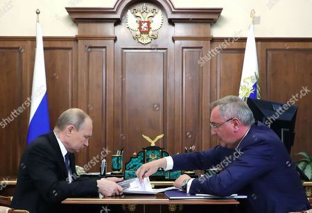 Russian President Vladimir Putin (L) and Roscosmos State Space Corporation Director General Dmitry Rogozin (R) talk during their meeting in Moscow, Russia, 01 August 2019.
